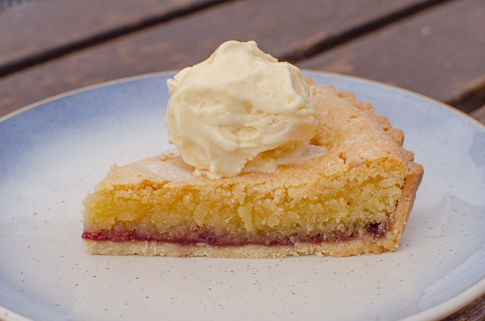 Bakewell Tart served warm with Vanilla ice cream.