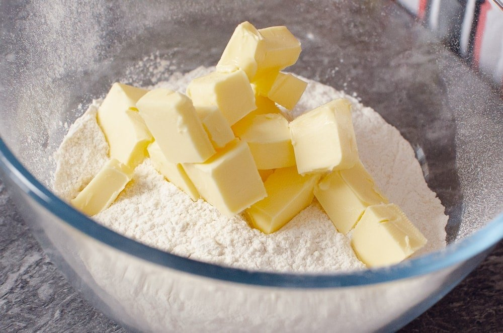 Blocks of butter and flour in a glass bowl