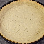 Sweet Shortcrust Pastry Tart cooked in a black tin