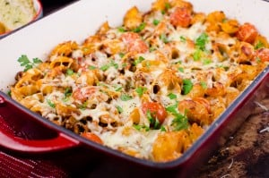 Cheesy Bolognese Pasta Bake, served in a ovenproof casserole dish with melted cheese