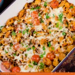Cheesy Bolognese Pasta Bake in a white dish image for pinterest