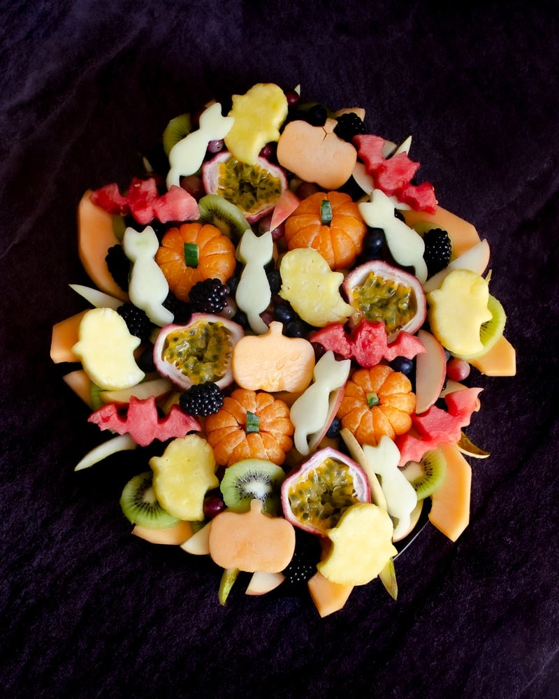 Halloween cut out shapes of cats,pumpkins,bats and ghosts onto our fruit salad on a black platter plate