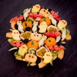 Halloween Fruit Salad with shapes of cats, pumpkin,ghost and bats with edible eyes