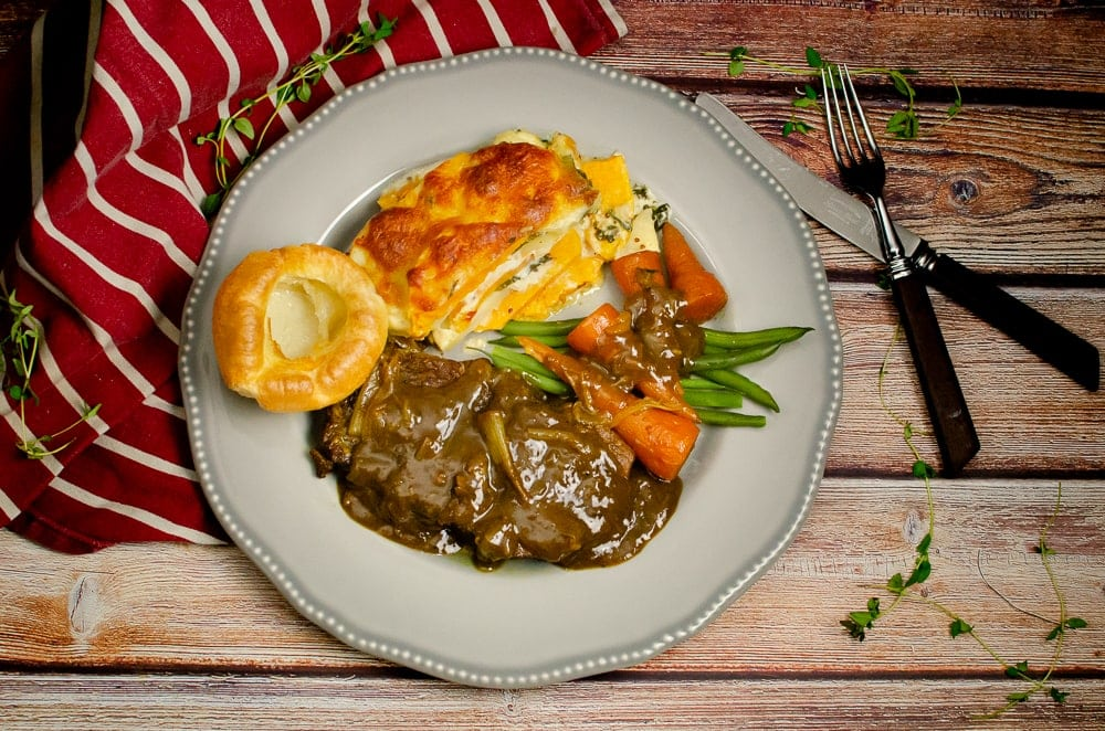 Braising Steak with Horseradish Gravy - Slow Cooked Beef served with sweet potato and parsnip gratin, flawless Yorkshire pudding, carrots and green beans