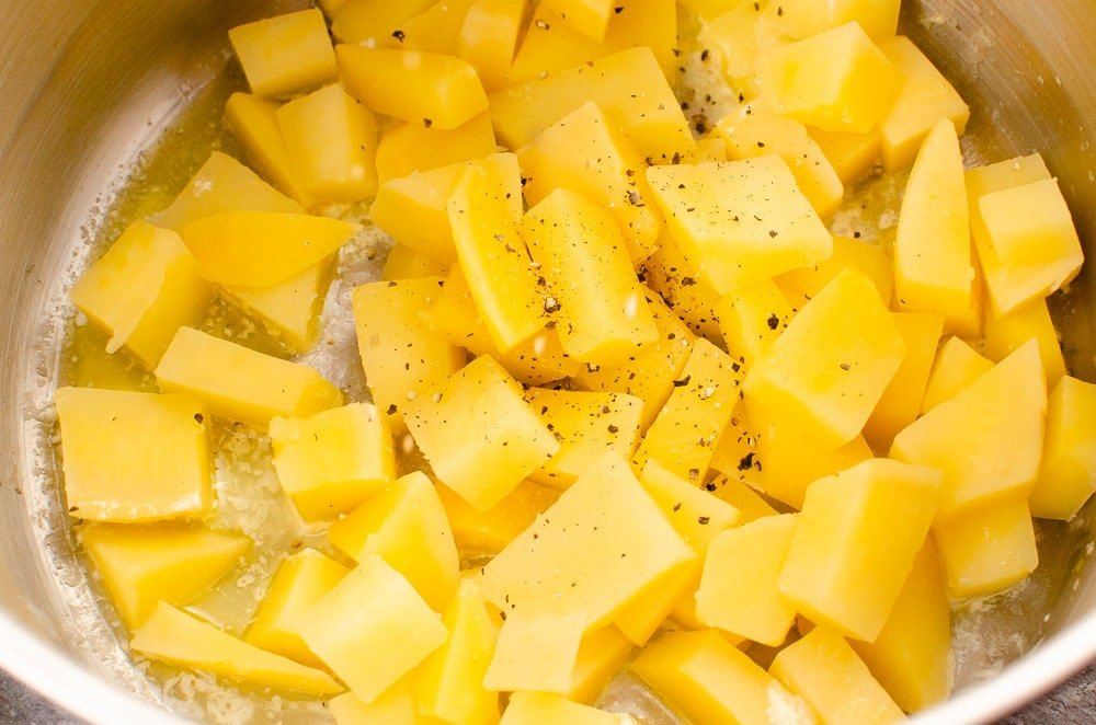 Cubed swede mixed with cream, butter and black pepper
