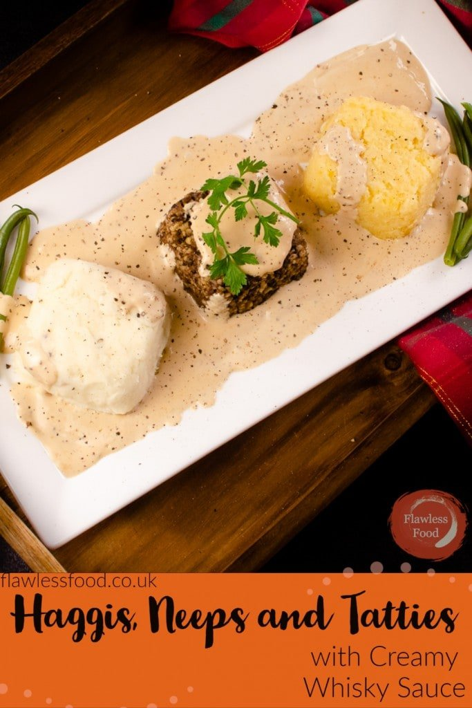 Haggis, Neeps and Tatties covered in creamy whisky sauce Image for pinterest served on a white plate