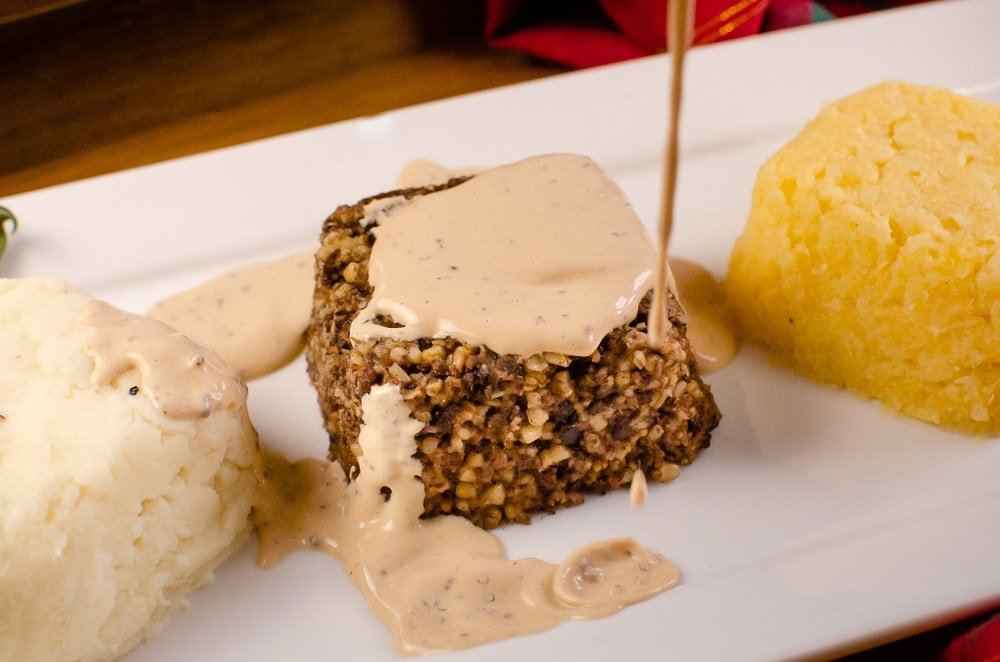 Pouring our Creamy Whisky Sauce over the top of our Haggis, Neeps and Tatties