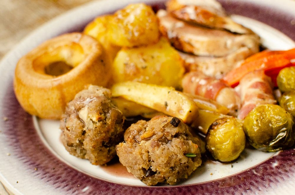 Sausage Meat Stuffing Balls with Apple and Chestnut plated with flawless Yorkshire pudding,sliced turkey, glazed brussels sprouts,pigs in blankets and Flawless roast potatoes