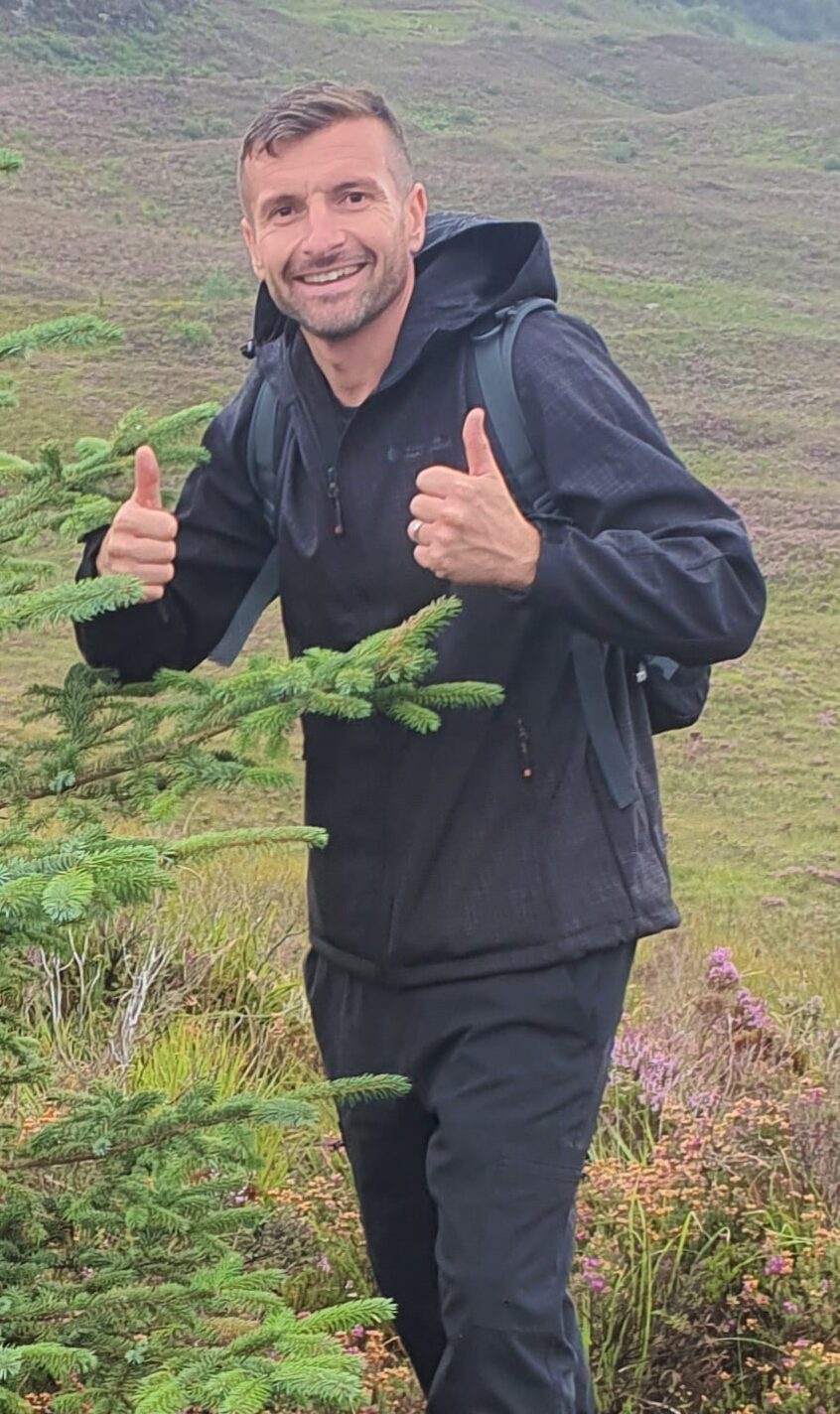 Luke with his thumbs up in the Highlands of Scotland