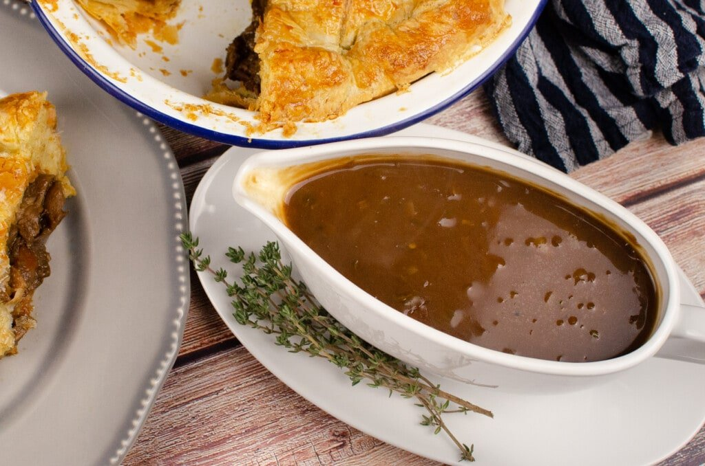Easy Onion Gravy with Ale in a white gravy boat