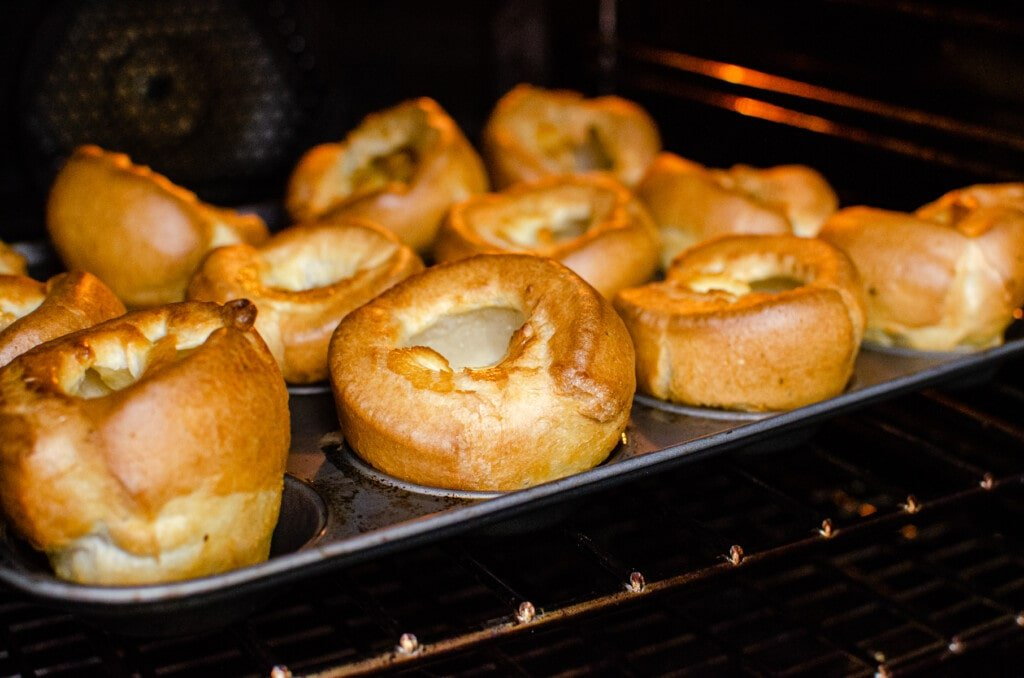 Flawless Yorkshire Puddings cooked and ready to come out of the oven
