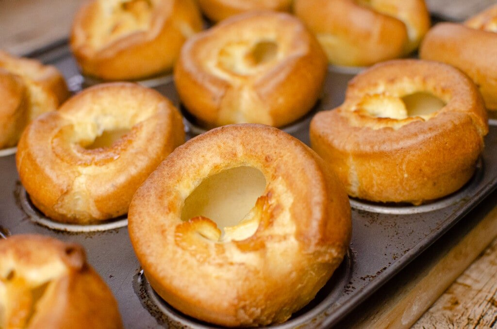 Crispy Yorkshire pudding cooked in a metal tray