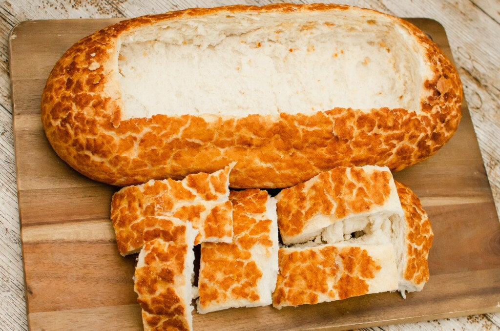 A tiger loaf with the middle cut out to form the bread boat for the fish chowder