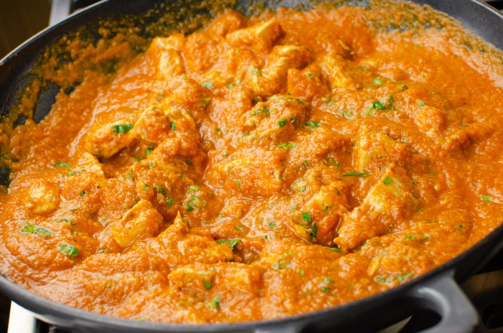 Chicken Pathia Curry in a cast iron pan
