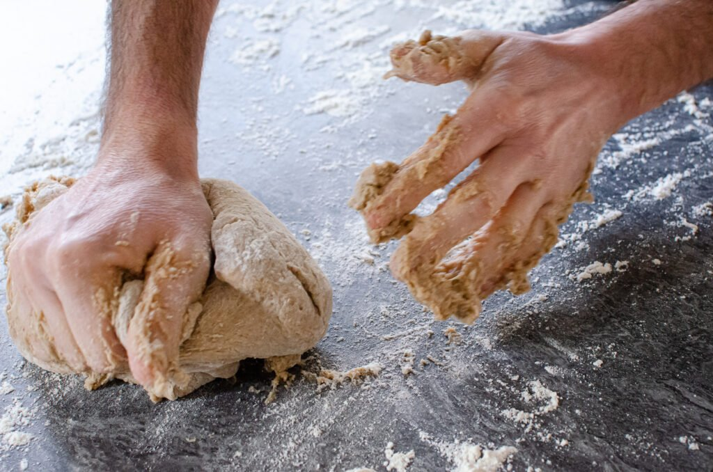 Kneading the dough on a floured surface to make our hot cross buns