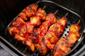 Cooked Tandoori Chicken Tikka Kebabs in a air fryer