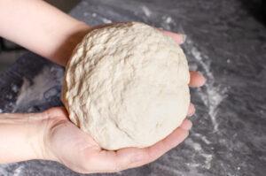 Bread dough in hands