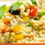 Pin image of our Summer Orzo Pasta Salad being picked up on a silver fork