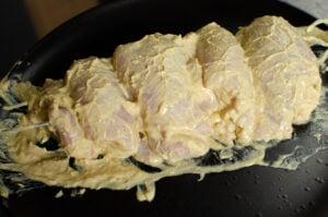Chicken kebab on skewers on a black plate
