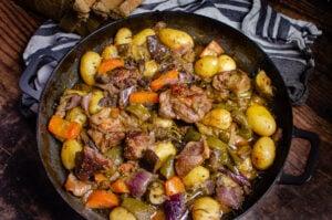 Croatian Lamb Peka served in a cast iron pan