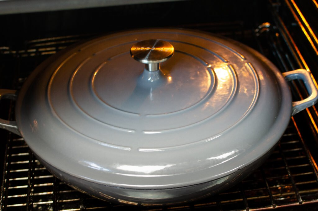 Cast iron dish with lid on in the oven
