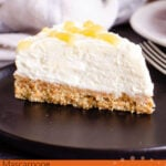 Pin image of our A slice of Lemon Curd Cheesecake on a black plate with a silver fork on the side