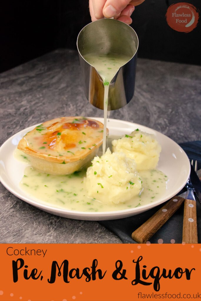Pin image of Pouring liquor from a silver jug onto pie and mash on a white plate with a knife,fork and spoon on the side