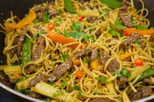 Beef Stir-fry with noodles in a wok
