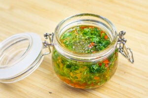 Chilli salad dressing in a clear glass pot