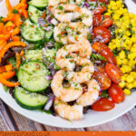 Pin image of our King Prawn Salad consisting of rocket leaves,sweet corn, chopped cherry tomatoes, cucumber, orange pepper, chilli salad dressing and sprinkled desiccated coconut all over the top