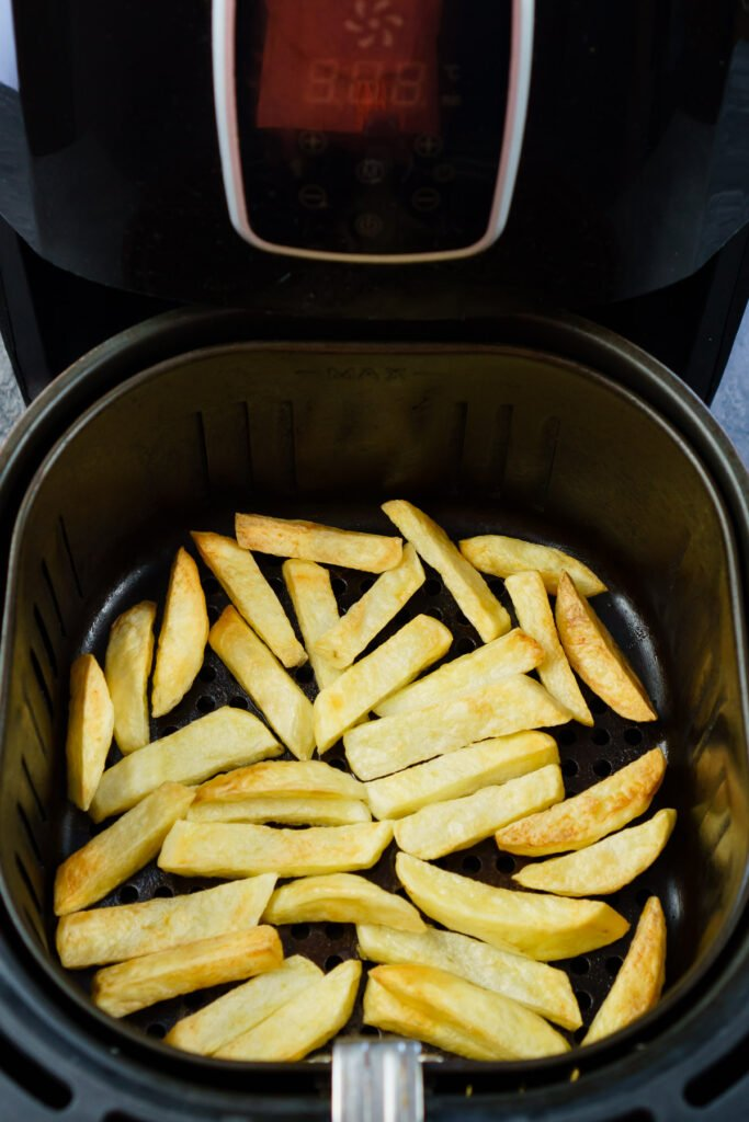 Cooked air fryer chips in a air fryer