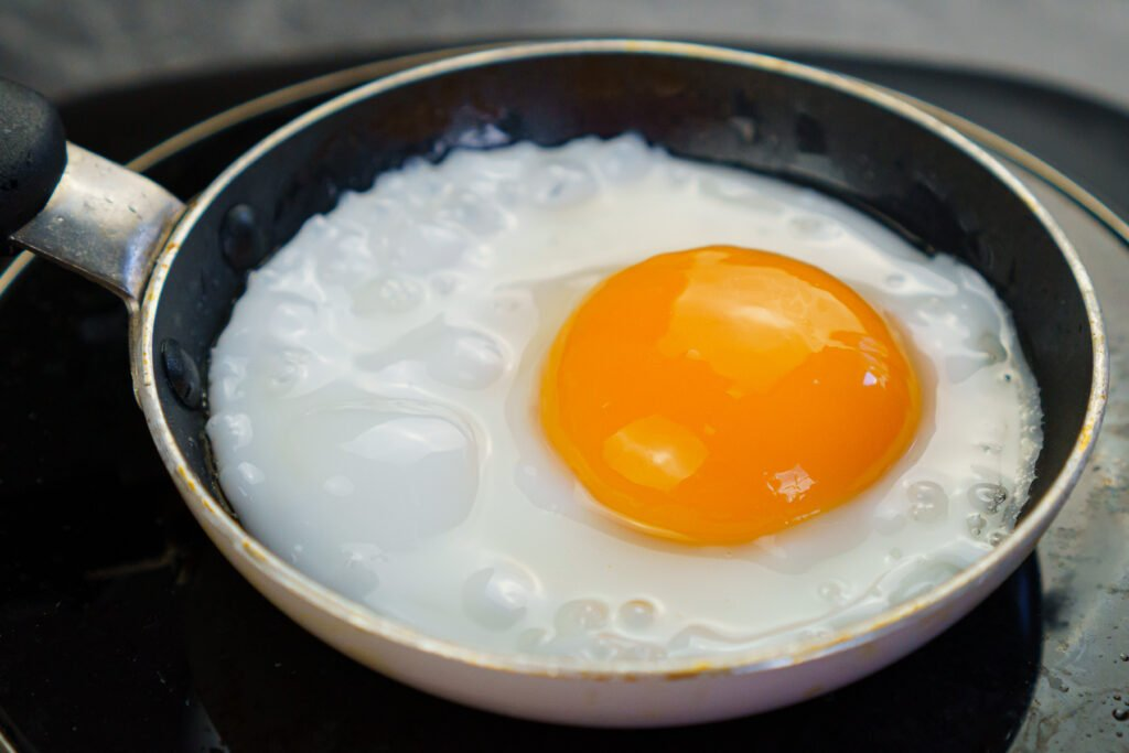 Cooking a duck egg in a mini frying pan
