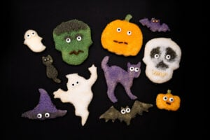 Halloween Sugar Bread cut outs shaped like a skull , pumpkin cat ,ghost ,vampire Frankenstein and a witches hat
