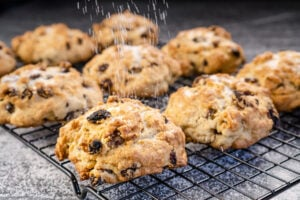 Rock cakes being sprinkled with sugar on top