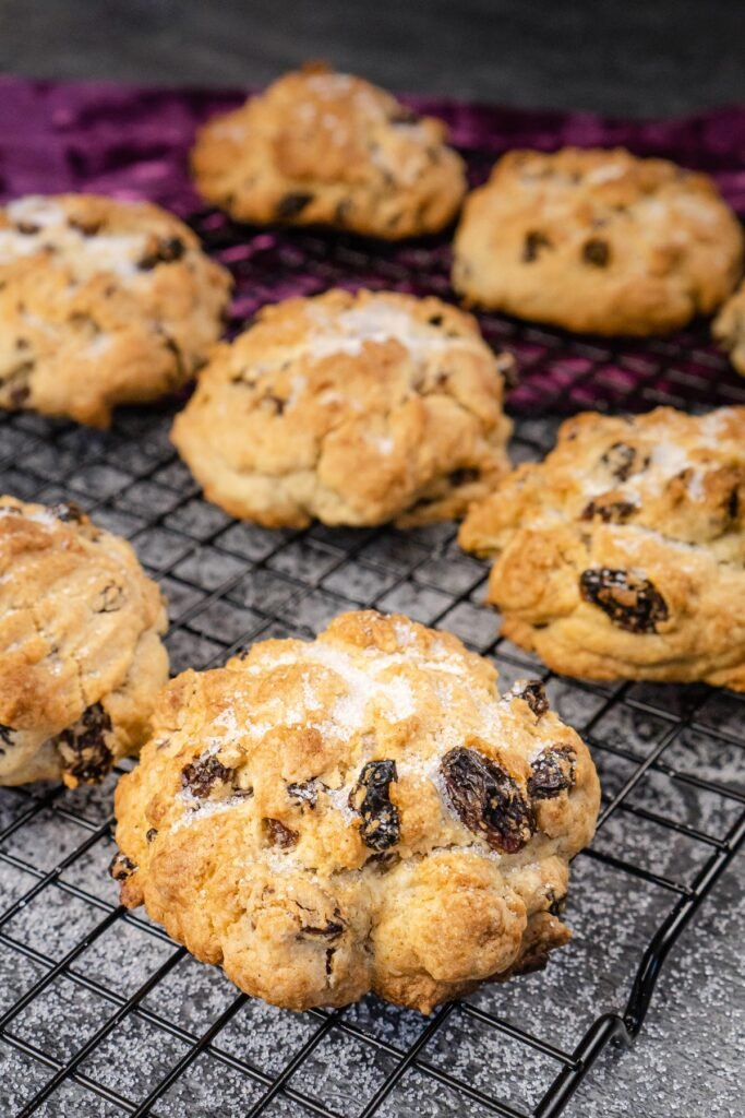 rock cakes on a wire rack with sugar over the top