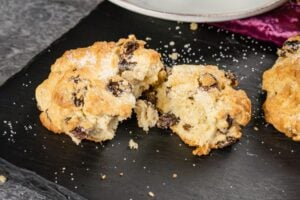 Rock cake with dried fruit broken in half served warm
