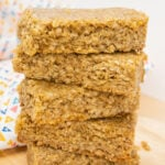Easy Flapjacks Recipe bars stacked up on a wooden board