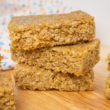Three Easy Flapjacks Recipe bars stacked up on a wooden board