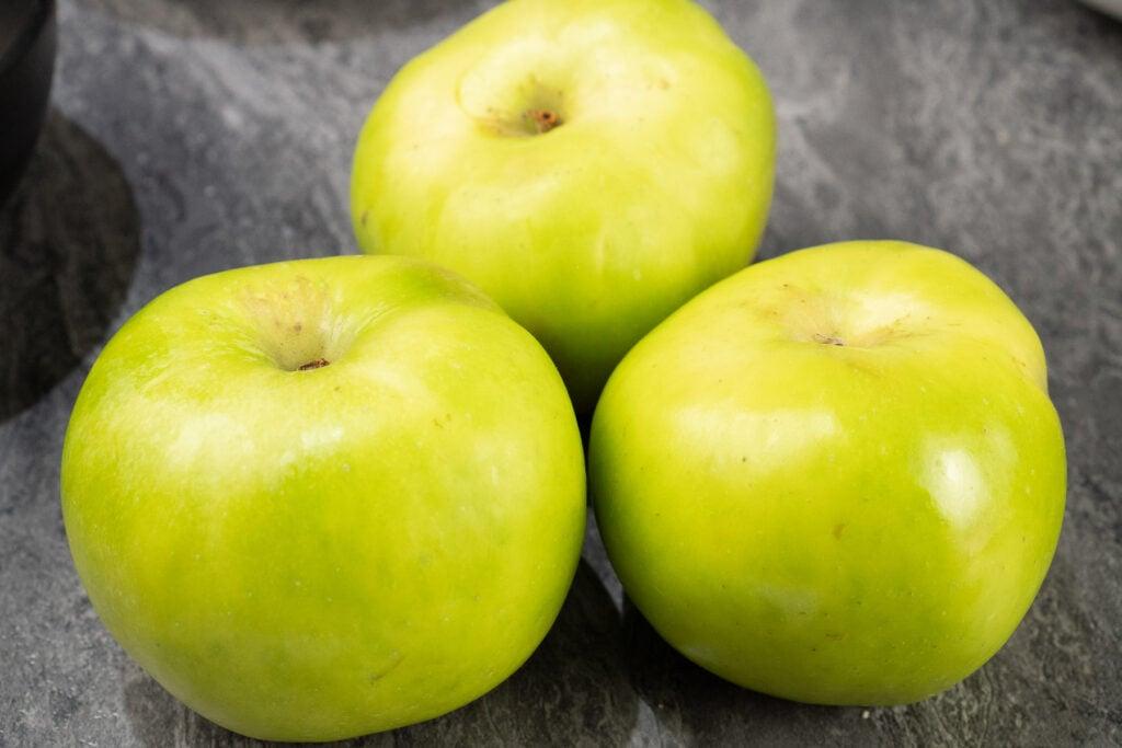 Three Bramley cooking apples